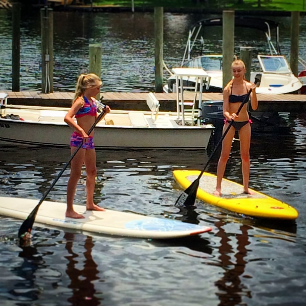 Children love stand-up paddleboarding!
