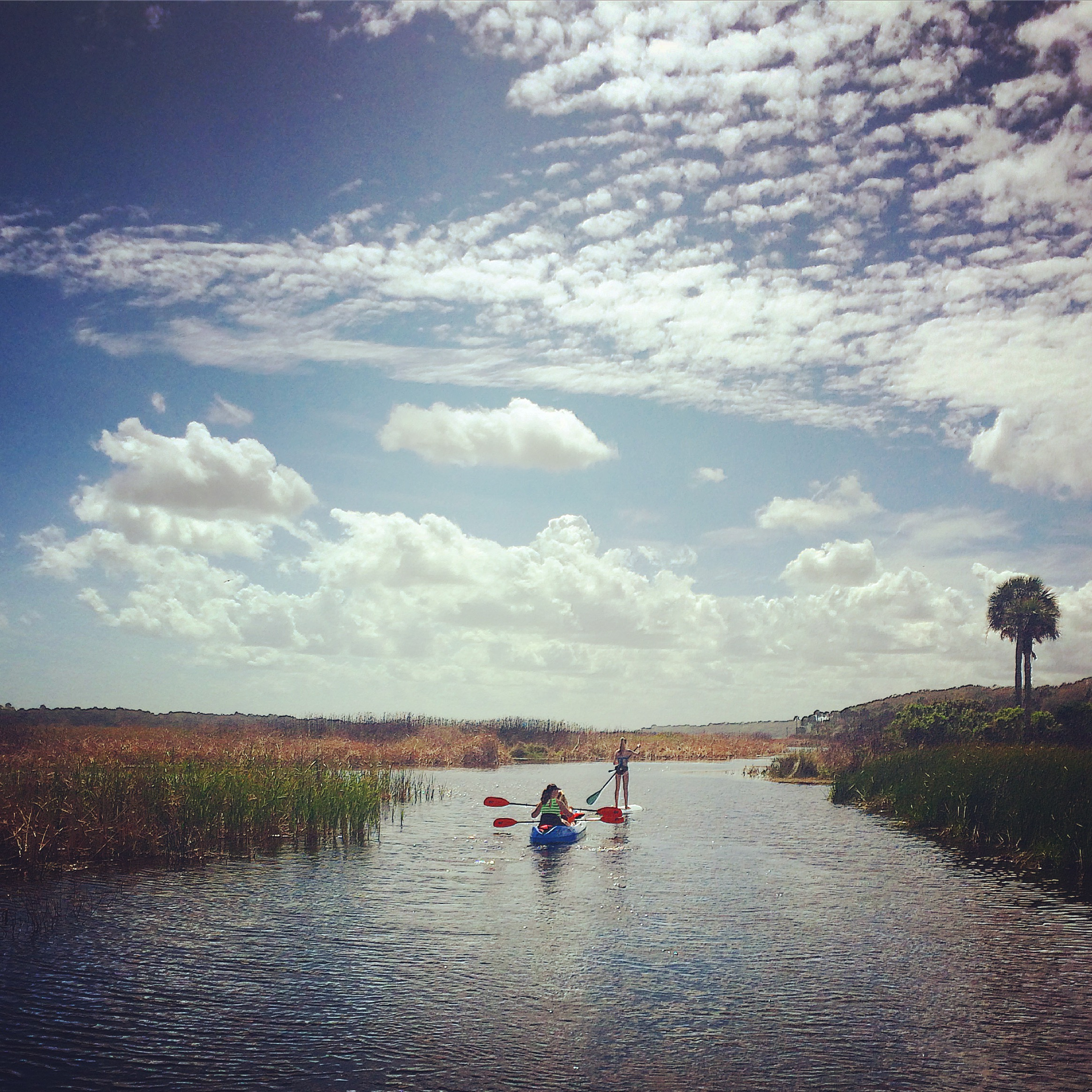 A kayaker and an SUPer on the Guana River in Ponte Vedra Beach, FL