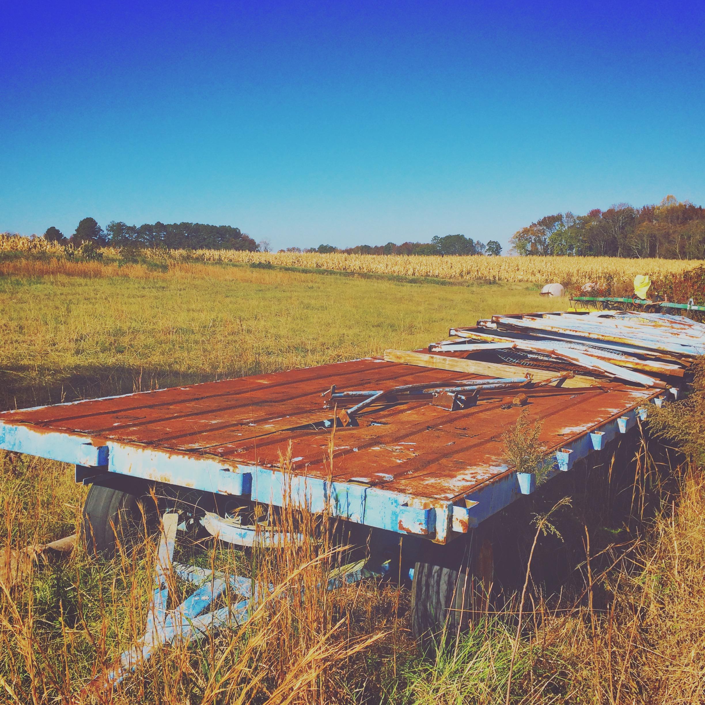 broken trailer in a corn field
