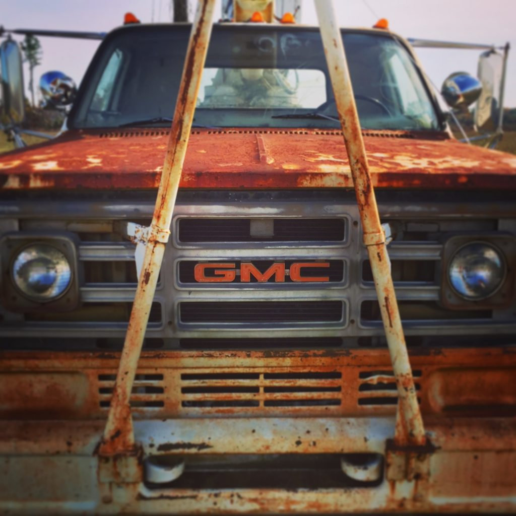 Rusty old GMC bucket truck