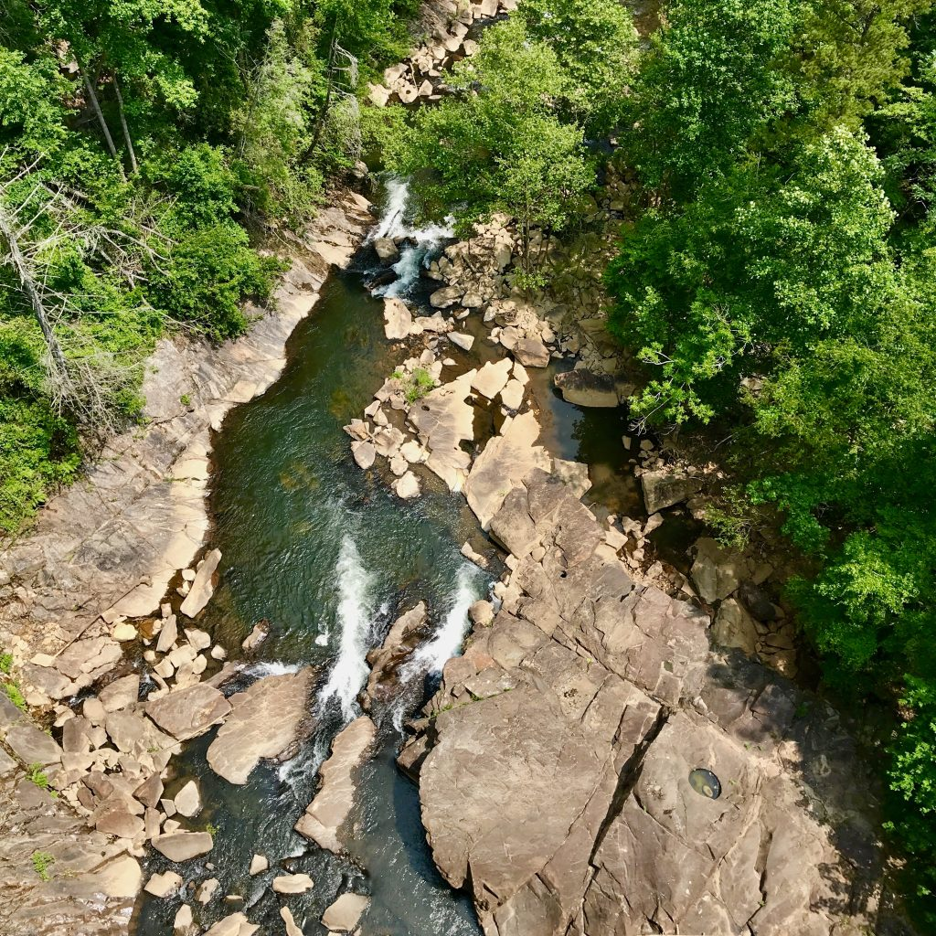 View from top of Tallulah Gorge looking straight down into rivier and boulders and rushing water.