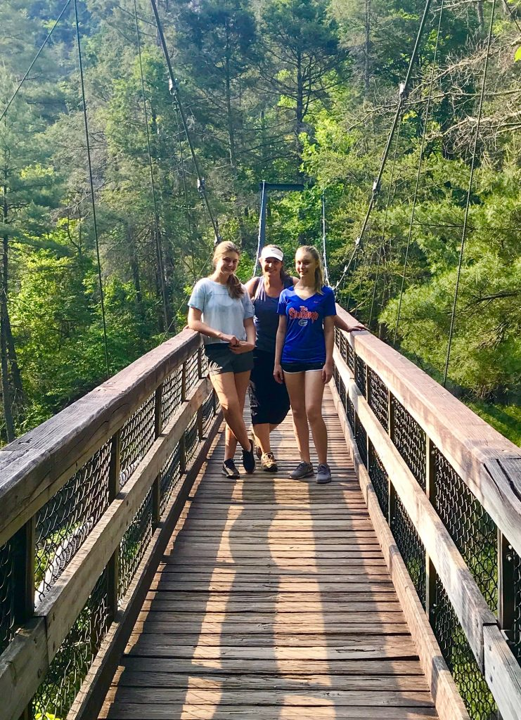 Family standing on the suspension bridge in Tallulah Gorge in north Georgia