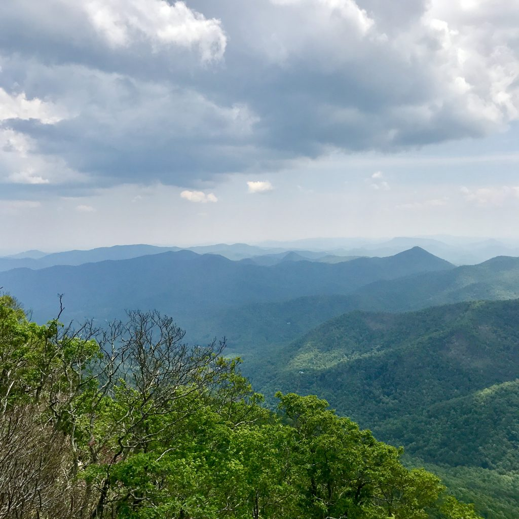 Dramatic view of green mountain range in summer at the top of Picken's Nose in North Carolina