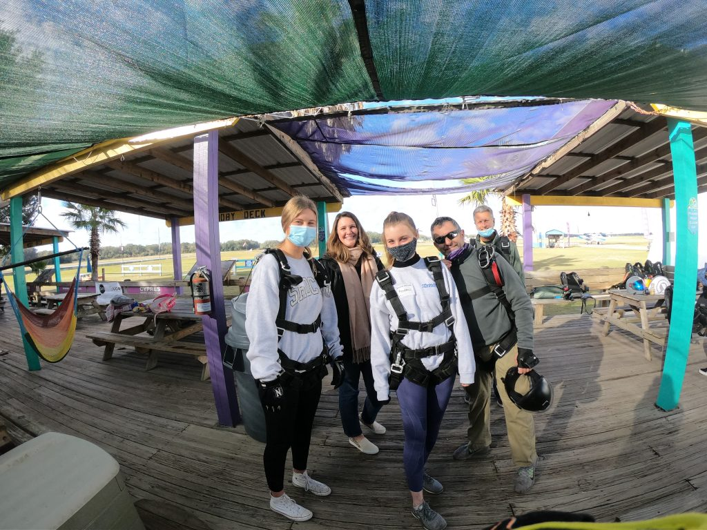 Family taking skydiving class, getting ready for a jump