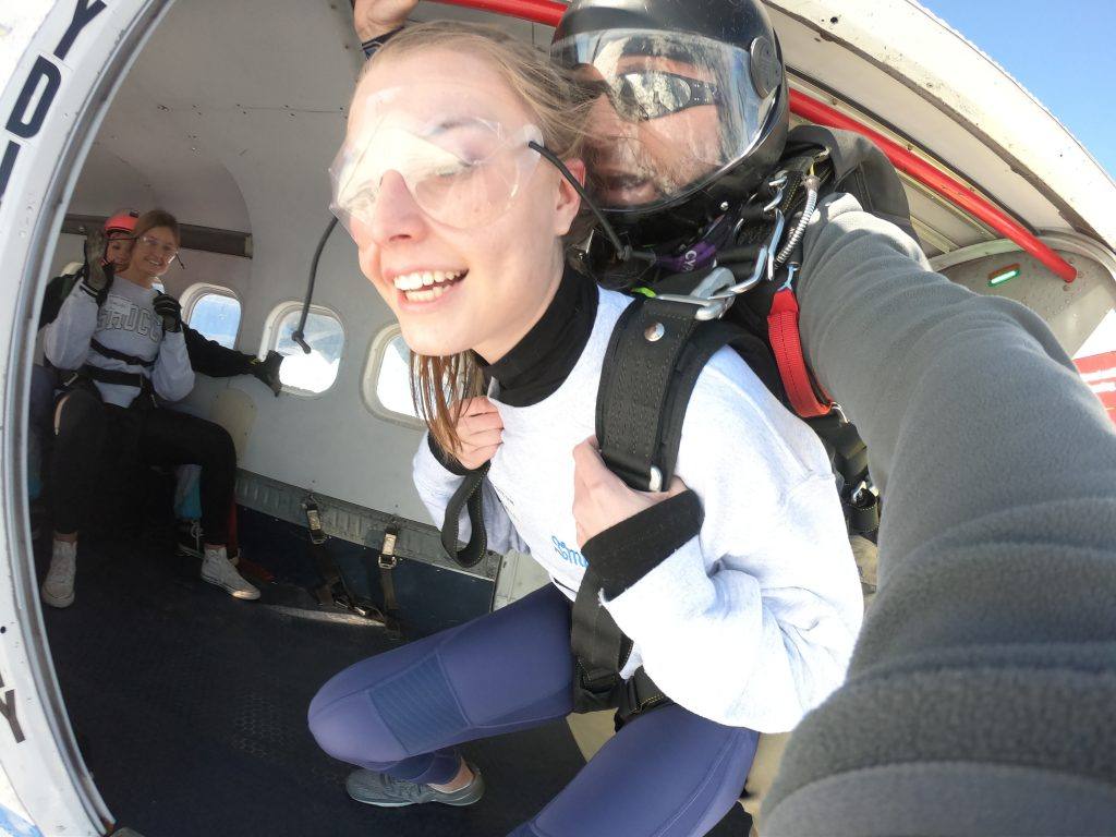Skydiver about to exit airplane on a tandem jump