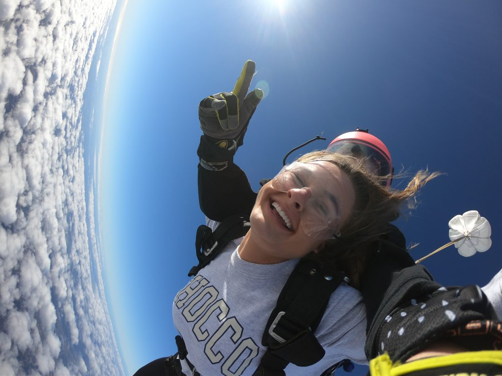 Two women skydivers on a tandem jump in Zephryhills, FL about to deploy their parachute