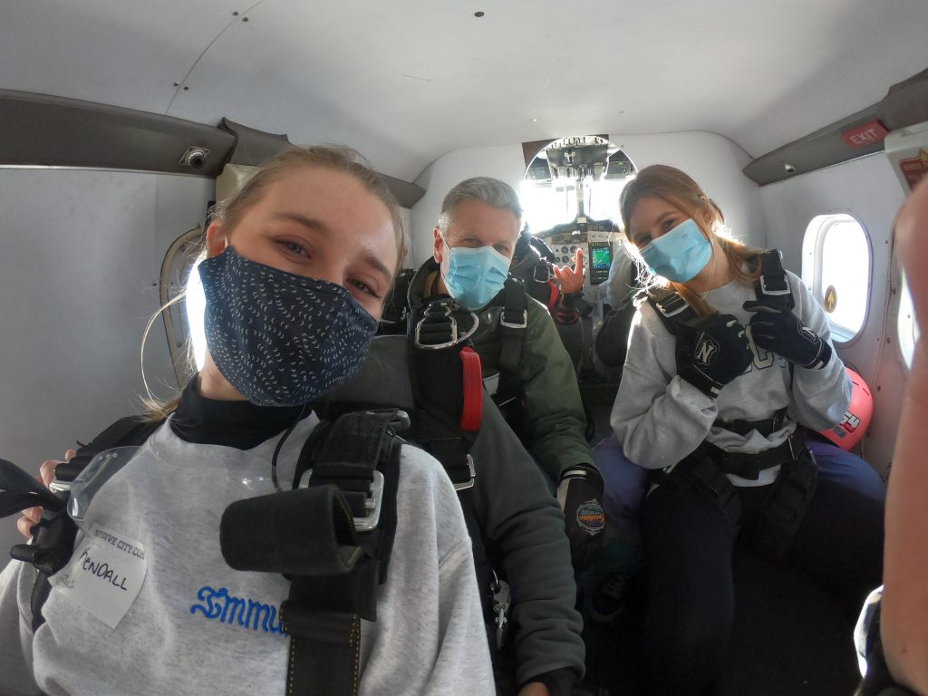 Father with daughters headed up in plane to go skydiving